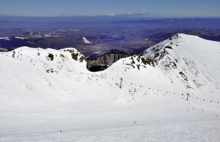ski runs: Ski runs and chairlift on Hala Gasienicowa in Tatra mountains in Poland with the far view of Zakopane ski resort and Podhale region