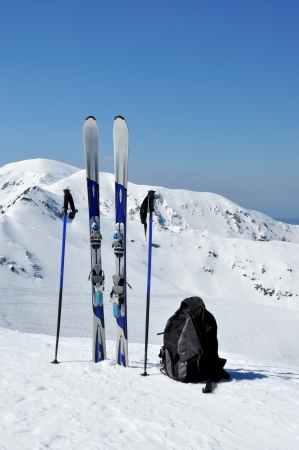 zakopane: A pair of skis, ski poles and a backpack in Tatra mountains in Poland