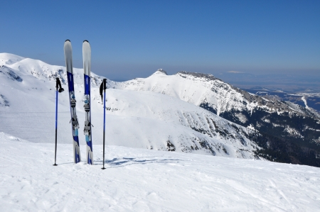 A pair of skis, ski poles and Giewont in Tatra mountains in Poland