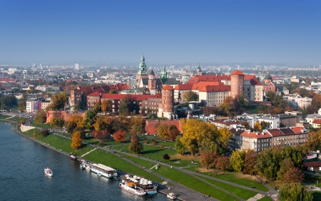 cracow: Panorama of Cracow, Poland, with royal Wawel castle and Vistula river in autumn  Aerial view at sunset