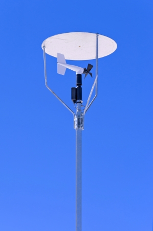 anemometer: Windmill style anemometer with a canopy on blue sky