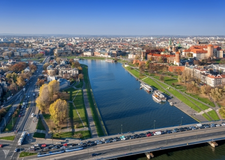 Panorama of Cracow, Poland, with Wawel castle, Vistula river and twoi bridges in autumn  Aerial view from the balloon at sunset  photo