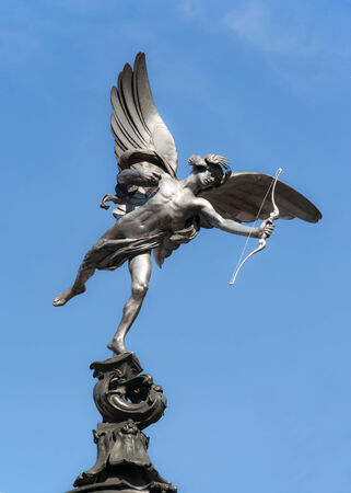 piccadilly: Eros statue at Piccadilly Circus in London on blue sky