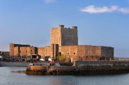 Medieval Norman Castle in Carrickfergus, Northern Ireland, in sunset light Publikacyjne