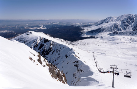 ski runs: Ski runs and chairlift on Hala Gasienicowa in Tatra mountains in Poland with the far view of Podhale region.