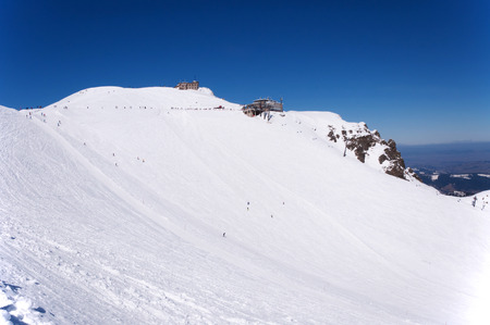 station ski: Ski area, run and pistes, chairlift, cable car station and the astronomical, meteorological observatory at the summit of Kasprowy Wierch and Hala Gasienicowa in Tatra Mountains in Poland