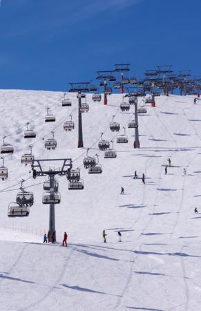 Skiers and double chairlift in Alpine ski resort in Solden in Otztal Alps, Tirol, Austria