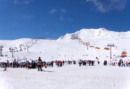 Crowd of skiers and chairlifts in Alpine ski resort in Solden in Otztal Alps, Tirol, Austria