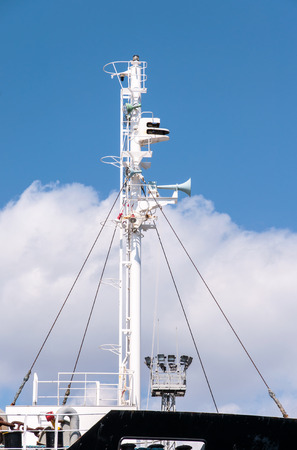 superstructure: Mast of a modern ship with a horn lamps and other equipment Stock Photo