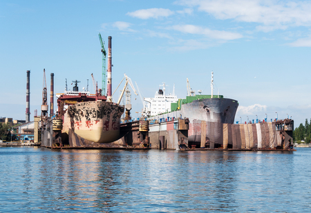 shipbuilder: Two ships in major renovation in ship repair yard in Gdansk Poland