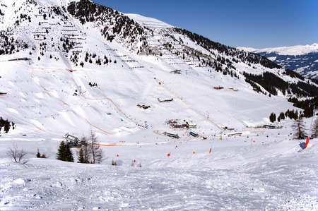 winter vacation: Mayrhofen Ski resort midle station area with ski lifts, pistes and skiers. Zillertal Alps, Tirol, Austria.