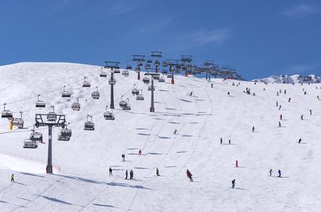 SKI: Skiers and double chairlift in Alpine ski resort in Solden in Otztal Alps, Tirol, Austria