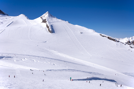 moguls: Hintertux Glacier with skiers, snowboarders, ski runs, pistes and ski lifts in Zillertal Alps in Austria Stock Photo