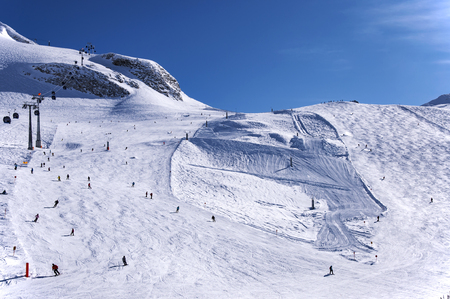 Ski Area: Hintertux Glacier with skiers, ski lifts, gondolas, ski runs and pistes in Zillertal Alps in Austria Stock Photo