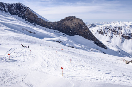 moguls: Hintertux Glacier with skiers, snowboarders, ski runs, pistes and ski lift in Zillertal Alps in Austria