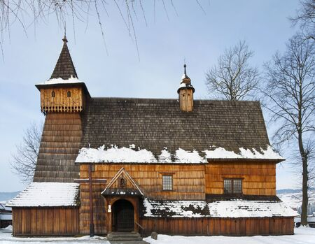 old church: Old medieval wooden church of the Saint Archangel Michael in Debno, Poland, in winter. UNESCO World Heritage