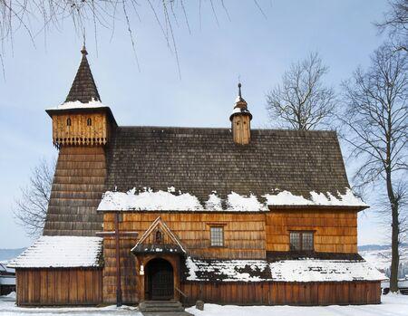 archangel: Old medieval wooden church of the Saint Archangel Michael in Debno, Poland, in winter. UNESCO World Heritage