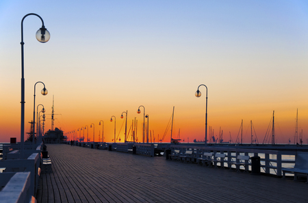 Sunrise at the pier wooden pier in Sopot, Poland