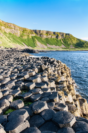 geological formation: Giants Causeway, unique geological formation of rocks and cliffs in Antrim County, Northern Ireland, in sunset light