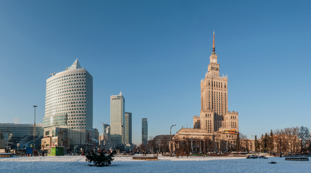 scrapers: WARSAW, POLAND - JANUARY 23, 2016: Panorama of Warsaw city center with Palace of Culture and Science (PKiN), a landmark and symbol of Stalinism and communism, and modern sky scrapers in winter at sunset Editorial