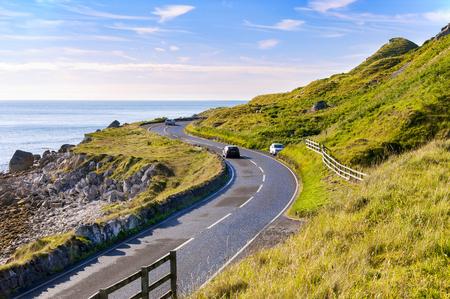 coastal: The eastern coast of Northern Ireland and Antrim Coastal road with cars