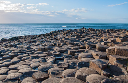 geological formation: Giants Causeway. Unique natural geological formation of hexagonal volcanic basalt rocks and stones on the coast of Antrim County, Northern Ireland, in sunset light Stock Photo
