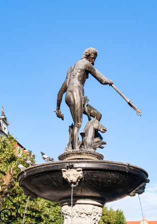 droppings: Neptune statue and fountain in Gdansk, Poland, dating from 1549, on blue sky, contaminated with pigeon droppings