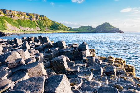 geological formation: Giants Causeway, unique geological hexagonal formation of volcanic basalt rocks and cliffs in Antrim County, Northern Ireland, in sunset light