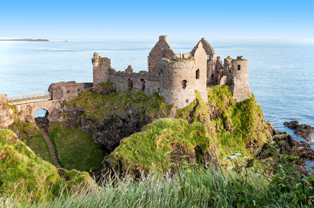 northern ireland: Ruins of medieval Dunluce Castle, County Antrim, Northern Ireland, at sunrise light