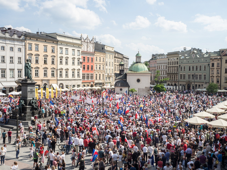 mickiewicz: KRAKOW, POLAND - JUNE 4, 2016: Demonstration and March of Liberty organized by KOD in Cracow, Poland on the anniversary of the first free election in 1989 after  the overthrowing of communism in Poland. Editorial