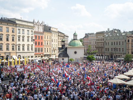 overthrow: KRAKOW, POLAND - JUNE 4, 2016: Demonstration and March of Liberty organized by KOD in Cracow, Poland on the anniversary of the first free election in 1989 after  the overthrowing of communism in Poland. Editorial