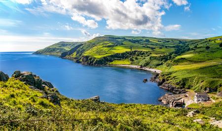 Côte nord, une baie et un petit port dans le comté d'Antrim, Irlande du Nord, Royaume-Uni Banque d'images - 61931146