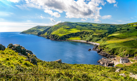 Northern coast, a bay and a small harbor in County Antrim, Northern Ireland, UK Фото со стока