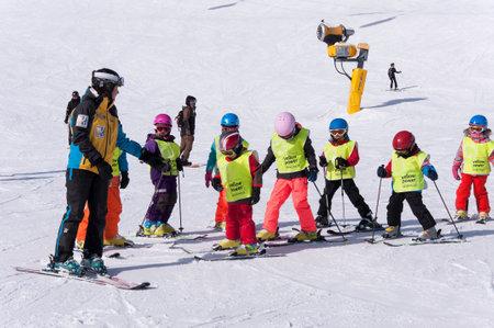 SOLDEN, AUSTRIA, MARCH 4, 2016: Ski school for children in Solden ski resort in Austrian Alps