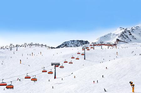 Skiers and chairlifts in Alpine ski resort in Solden in Otztal Alps, Tirol, Austria