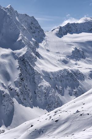 steep: Ski lift, run and piste on Rettenbach Glacier in Solden ski resort in Otztal Alps in Tirol, Austria
