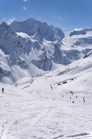 ski runs: Ski lifts, skiers and pistes to Rettenbach Glacier in Solden ski resort in Otztal Alps in Tirol, Austria