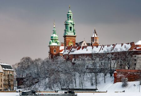 Wawel Cathedral towers in Krakow, Poland in a cloudy day in winter in last sunset light before the snowfall Editorial