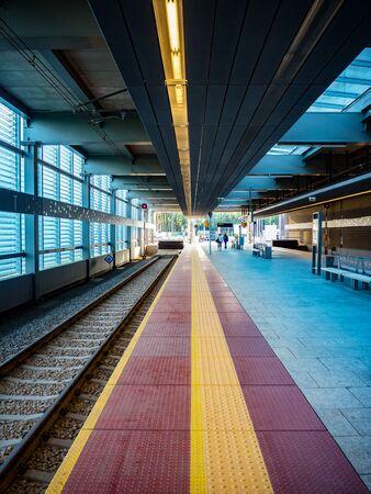 Modern railway platform at the terminal station