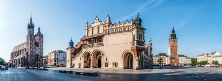 Panorama of Main Market Square (Rynek) in Cracow, Poland with the Renaissance Drapers Hall (Sukiennice), Gothic St Mary church and medieval city hall tower. The biggest medieval market square in Europe