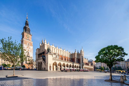 rynek: Main Market Square (Rynek) in Cracow, Poland with the Renaissance Drapers Hall (Sukiennice), and medieval town hall tower. The biggest medieval market square in Europe Stock Photo