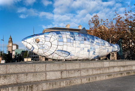 northern ireland: BELFAST, NORTHERN IRELAND, UK - SEPTEMBER 25, 2016: The Big Fish statue in Belfast, Northern Ireland.  A printed ceramic mosaic sculpture. A well known Belfast landmark in Donegall Quay