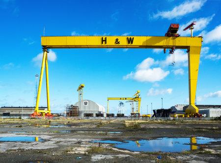 BELFAST, NORTHERN IRELAND, UK - SEPTEMBER 25, 2016: Samson and Goliath. Twin shipbuilding gantry cranes in Titanic quarter, famous landmark of Belfast, Northern Ireland. Goliath is in the foreground. Editorial