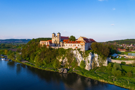 Benedictine monastery on the rocky hill in Tyniec near Cracow, Poland and Vistula River. Aerial view at sunset