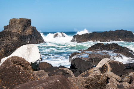 Rocks, waves and breakers at Ballintoy harbor, Northern coast of County Antrim, Norther Ireland, UK. The place featured in the Game of Thrones