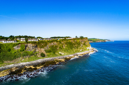 Atlantic coast with steep cliffs at Ballycastle, County Antrim, Northern Ireland, UK. Aerial view 스톡 콘텐츠