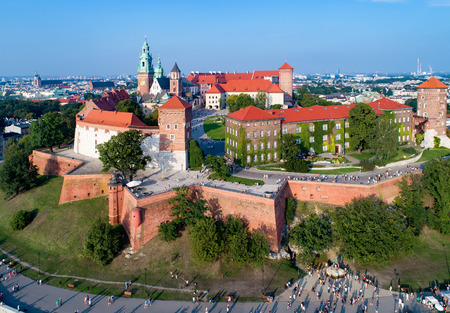 Krakow, Poland. Wawel Hill with Cathedral, Royal Castle, defensive walls, park, promenade and unrecognizable walking people