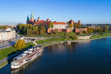Krakow, Poland. Wawel  Castle, Cathedral and Vistula in fall at sunset