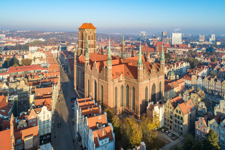 Gdansk old city in Poland with medieval Gothic Saint Mary Cathedral . Aerial view in sunrise light. Early morning Foto de archivo
