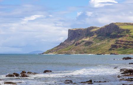 Famous Fair Head cliff on the Northern coast of County Antrim, Northern Ireland, UK. Sunset light 写真素材